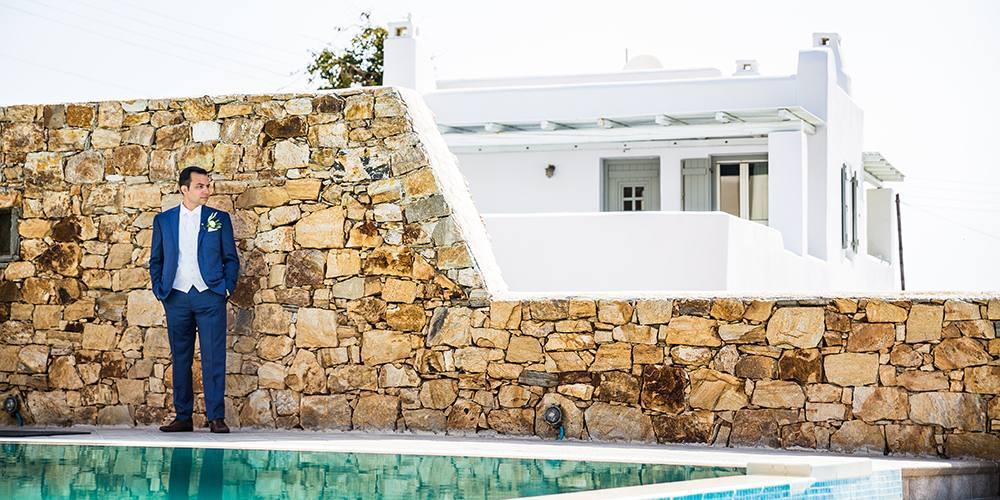 Groom by the pool in a villa