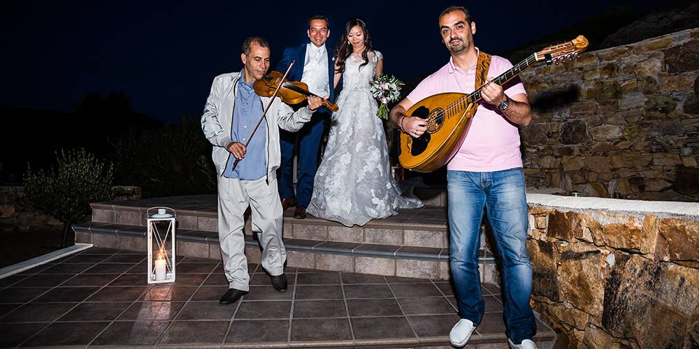 Wedding traditional musicians and the couple